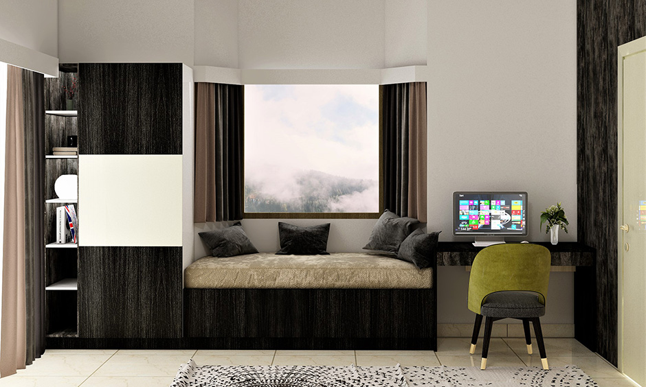 Window side seating colour ideas with white-themed room with a dark accent wall.