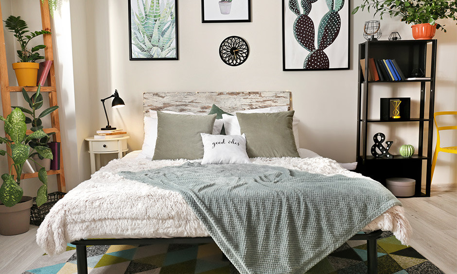 Cozy comfy bedroom decor with furry blankets, a geometric patterned rug and gingham pillows stands out.