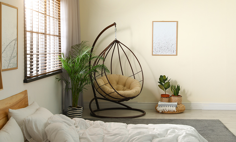 Cozy room with a swing chair is a perfect place to take an afternoon nap.