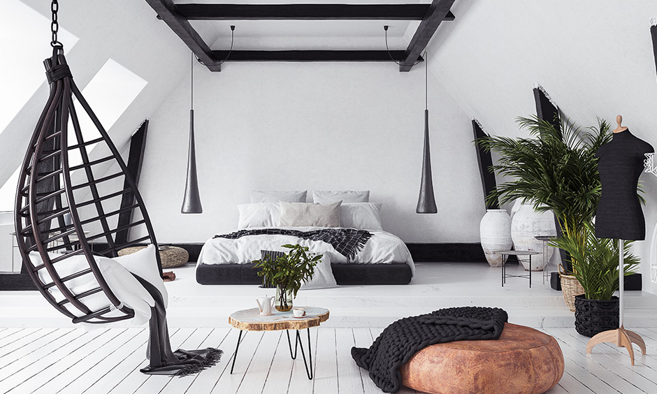 Wooden beams add immense warmth to spaces and a great decor element in the cozy bedroom.