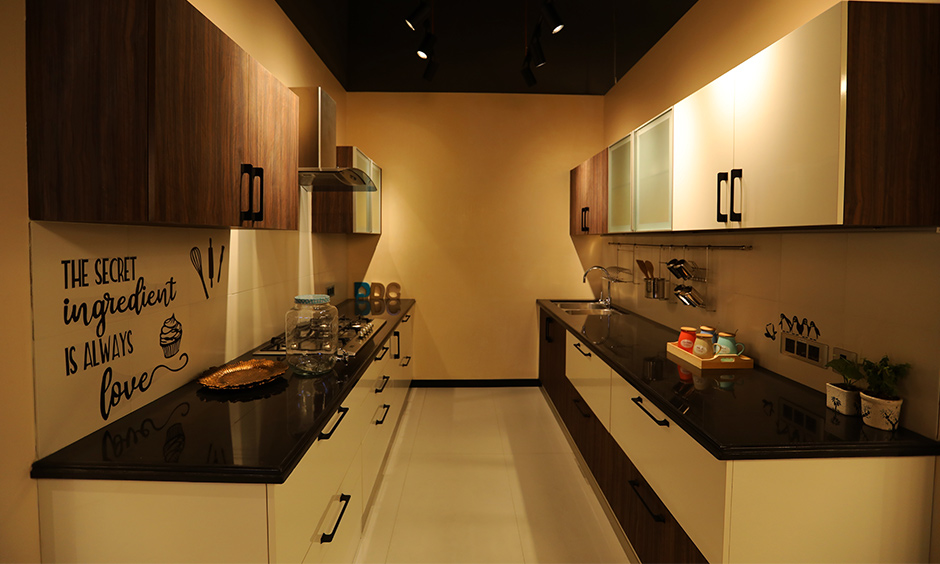 Modern classic kitchen design a counter made of black granite to give a clean seamless look.