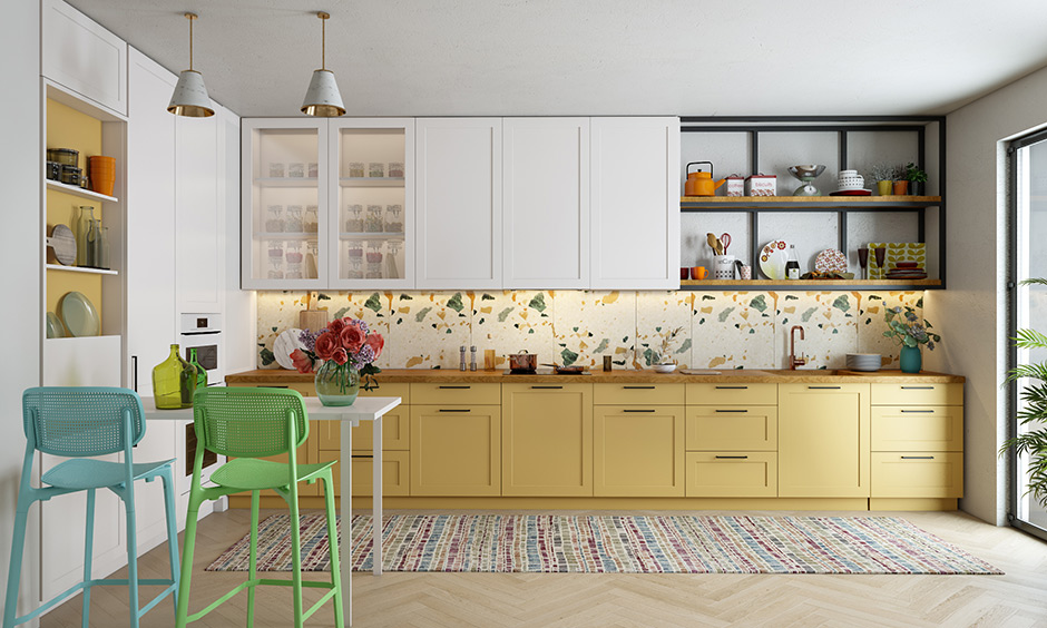 Newest kitchen trends 2020 with a colourful touch with cabinet , bright walls and vibrant pottery