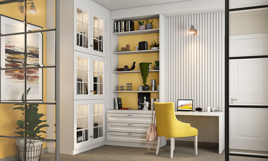 A white charming study room idea with a mirrored cabinet in white and a built-in unit with ledge shelves and drawers