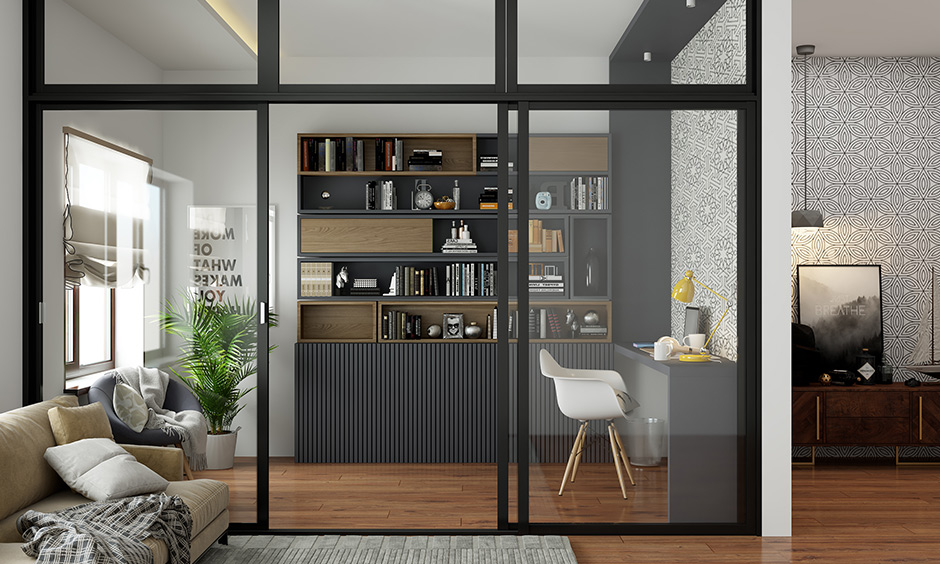 Modern study room design style with dual-toned open shelves, a wall-papered wall and black ledge study table