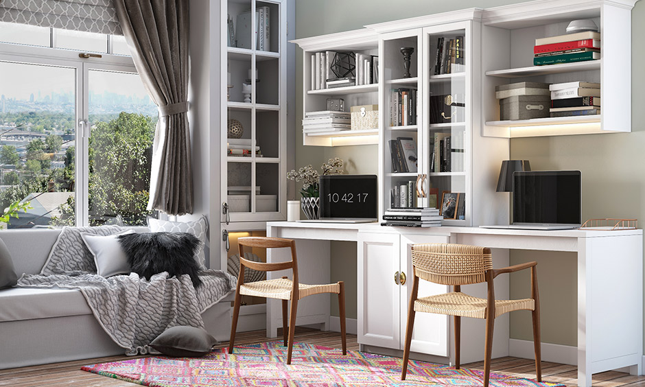 Study room interior design with upper west style with multiple storage options and study table with wicker chair