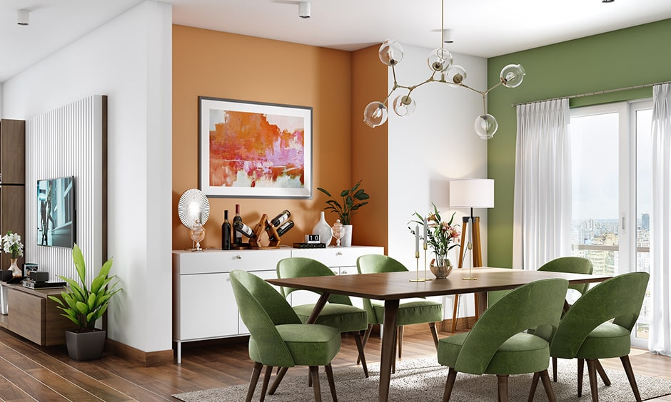 Two colour combination for dining room with a muted shade of green and pale orange