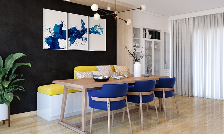 Dining hall colour combinations with black color wall, blue chairs and yellow decor