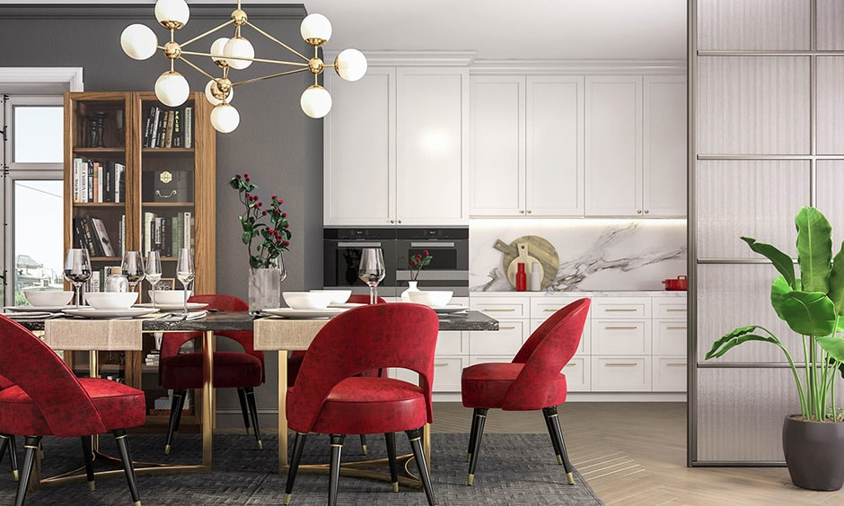 Dining room color combination with red chairs, white cabinetry and grey display wall