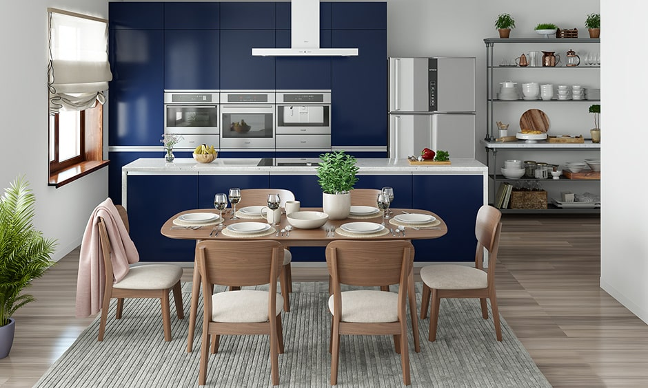 Dining room colour combination with blue cabinets, wooden furniture and white walls