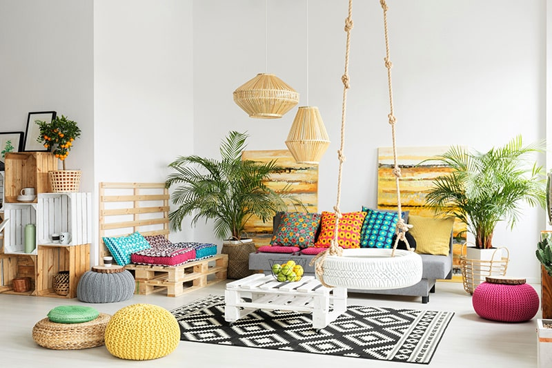 Creative home decor ideas by upcycling to make a hanging wheel swing, multi coloured poufs