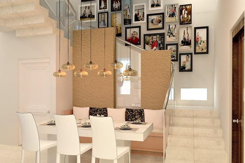 Creative home decor idea in stairway with well-composed gallery wall with mix-and match picture frames