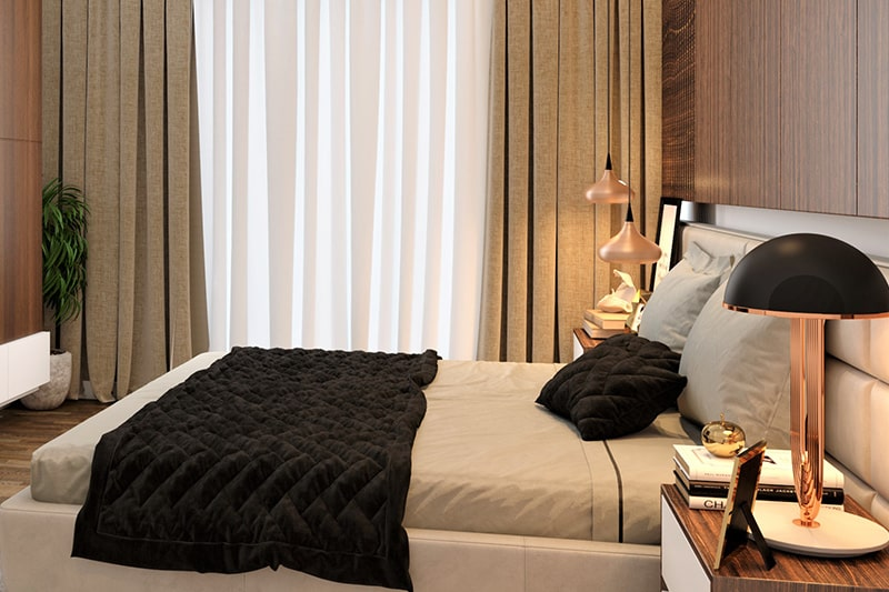 Home decor with the brass table lamp and a pair of hanging pendant lights gives luxury look to your bedroom