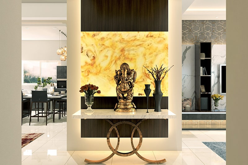 Home entrance decor with the ganesha idol and white marble-top side table stand