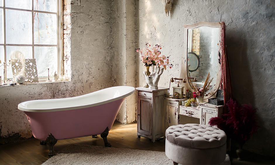 The Victorian styled bathroom features old school decor, and grunge walls are rustic master bathroom ideas.