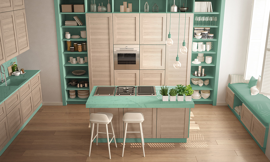 Aquamarine and beige themed green kitchen give a contemporary look.