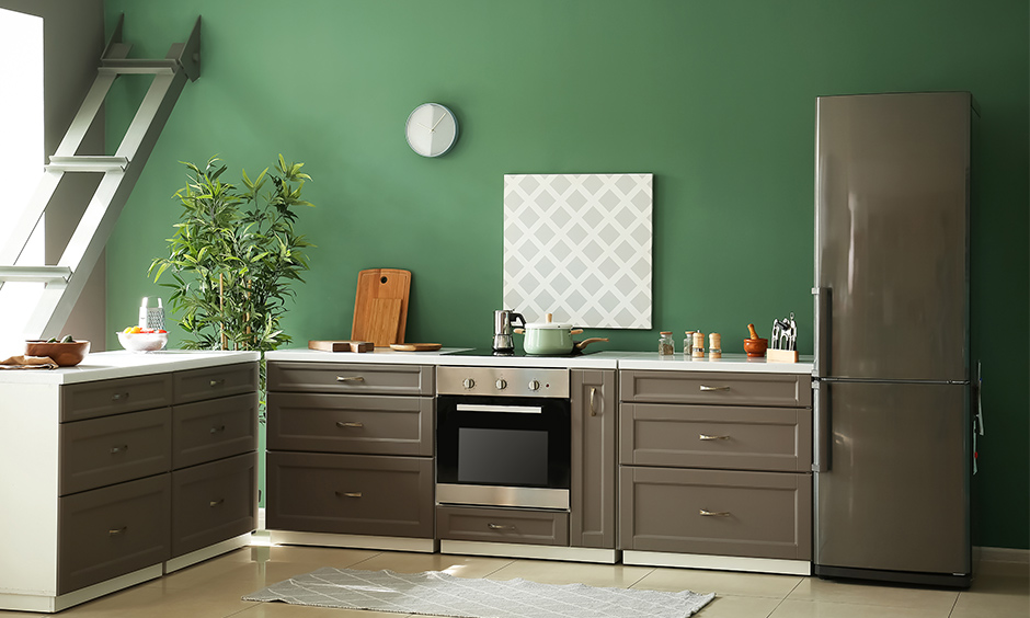 Bottle green colour kitchen with grey kitchen cabinets combination brings emotional feel.