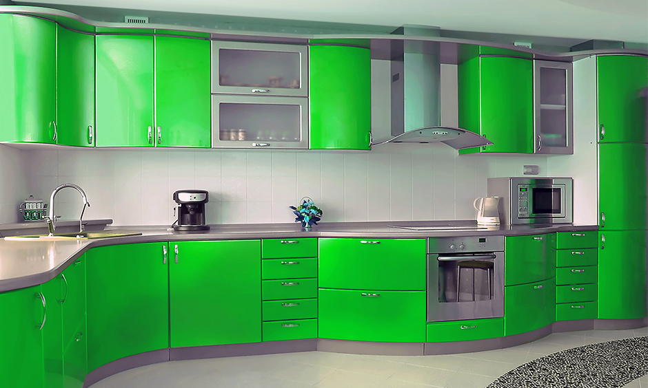 Bold electric green kitchen colors give the cooking area a futuristic look and instantly ups the energy.