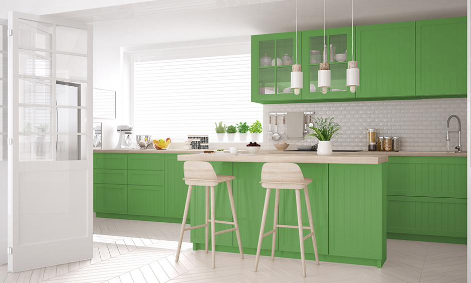 Combination of the white and green kitchen with light brown countertops looks modern.
