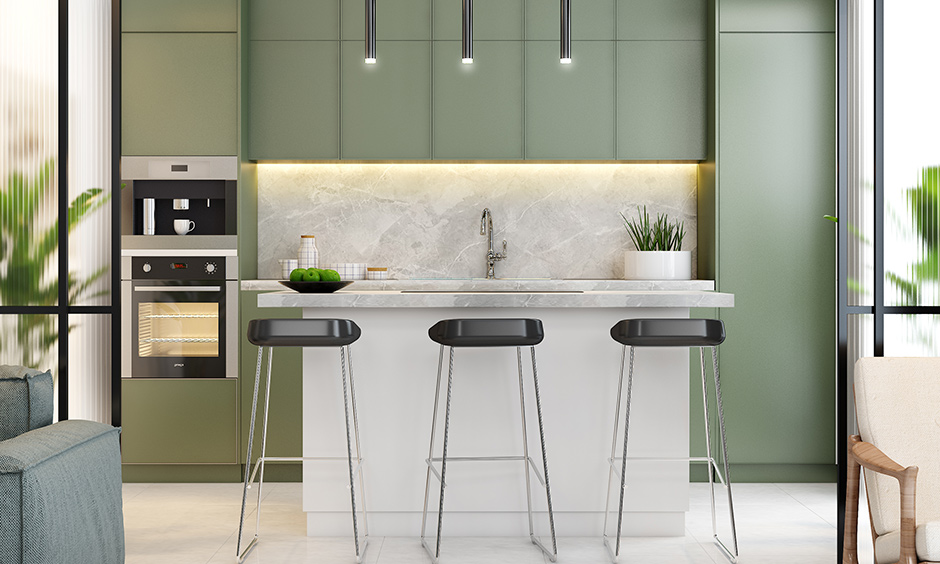Grey-green kitchen colours give the modular kitchen a contemporary look.