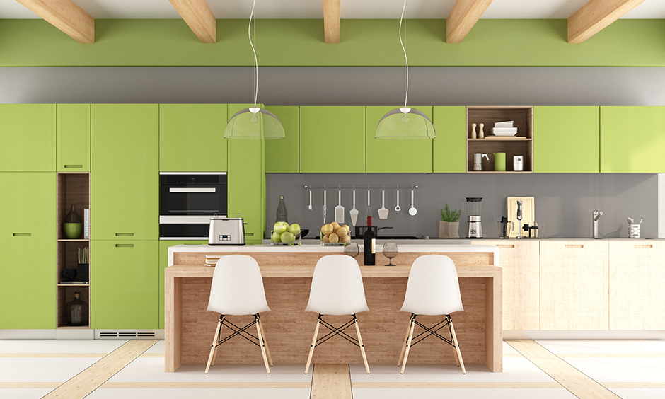 Pale green colour kitchen cabinets with light grey on the walls represent making a fresh start.