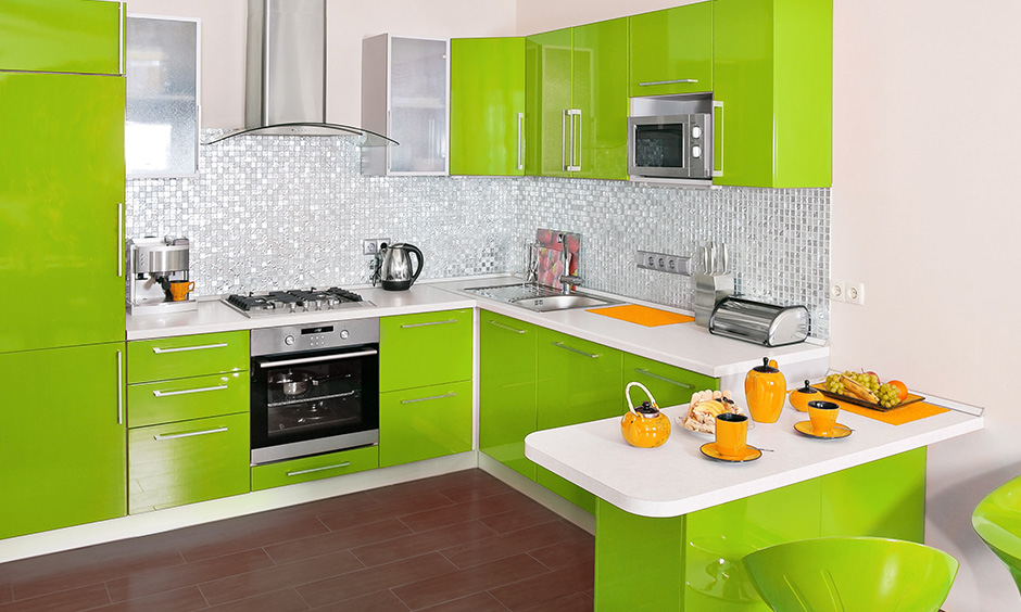 Lime green kitchen cabinets with plain white countertop give the vibrant and lively feeling.