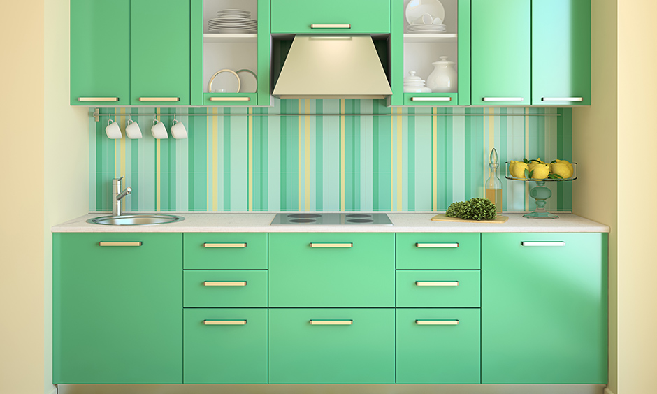 Pastel green kitchen ideas pair the striped kitchen wallpaper with solid green kitchen cabinets gives doll-house like look.