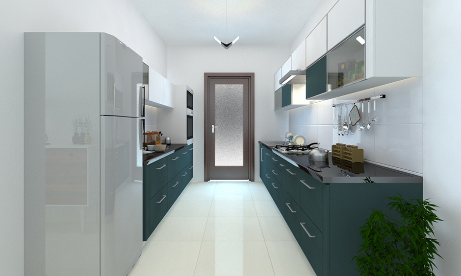 Darker shades of pine green kitchen cabinets with white walls reflect a sense of comfort.