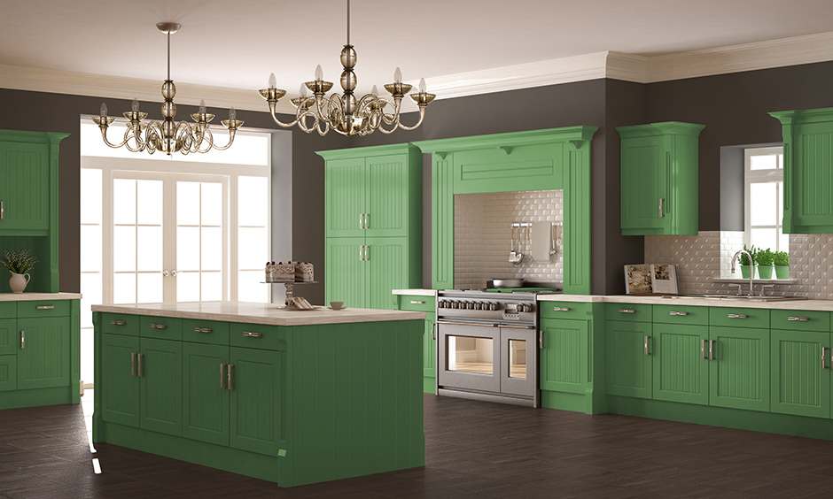 Green kitchen cabinets with dark grey on the walls represent trust and generosity of spirit.