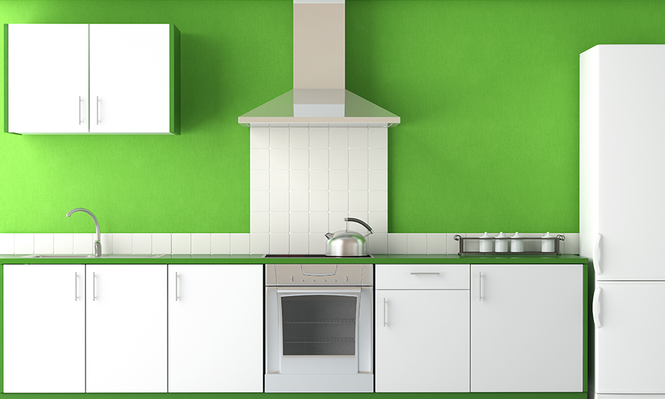 Green kitchen walls and white kitchen cabinets colour combination is the easiest on the eye.