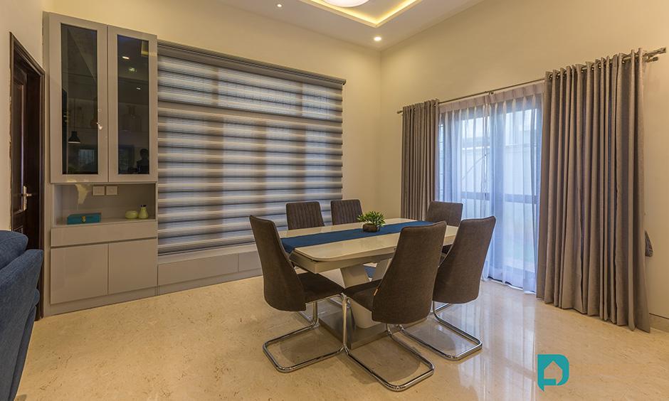Modern villa interior design of the dining area and kitchen nook using latest villa interior decoration pictures.