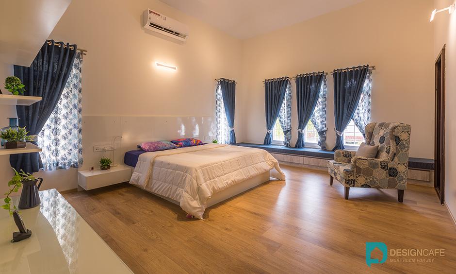 Villa bedroom design for a master bedroom in contemporary luxury villa room interiors style. Adarsh Palm Retreat Bedroom.
