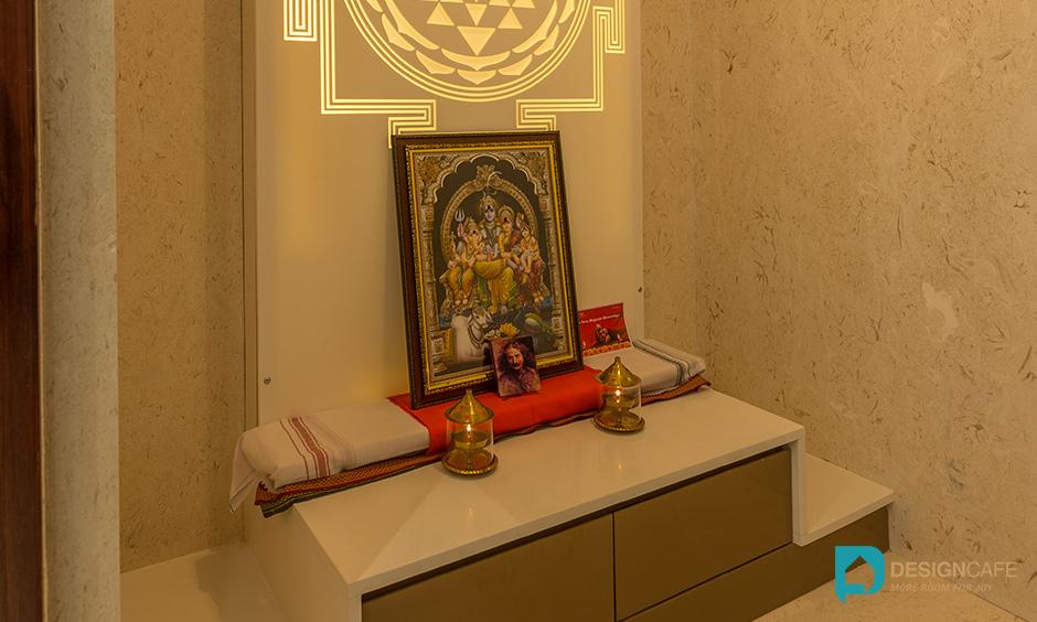 Pooja room design for a villa project using white marble for luxury villa interior design. Adarsh Palm Retreat Pooja Room.