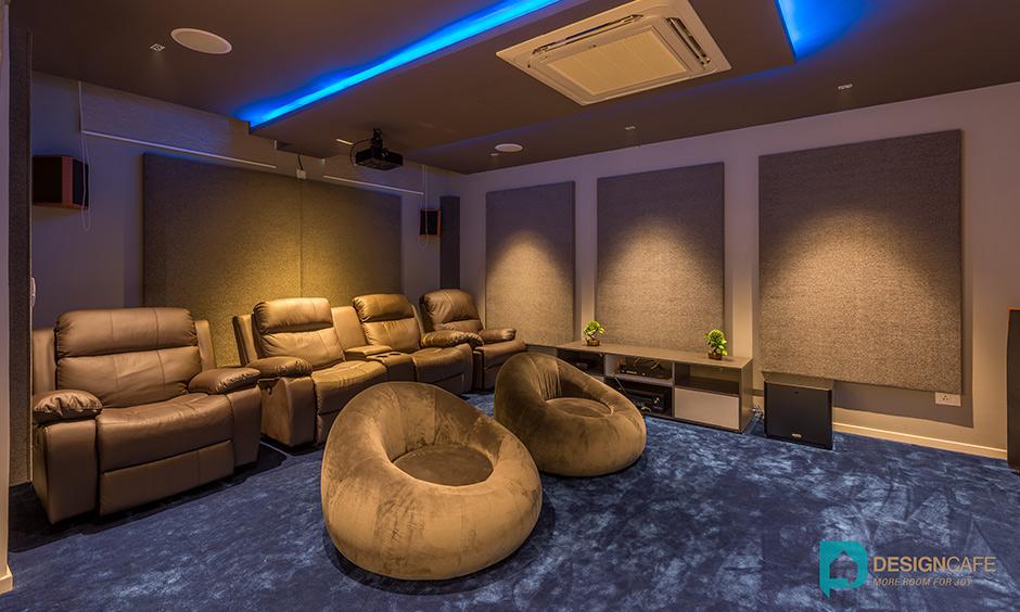 Villa interior design with an ampitheatre - home theatre - movie room for a modern duplex villa interiors.