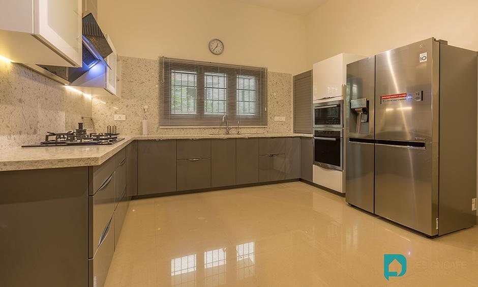Villa Kitchen design for a modern luxury villa interior design in bangalore images. Adarsh Palm retreat kitchen.