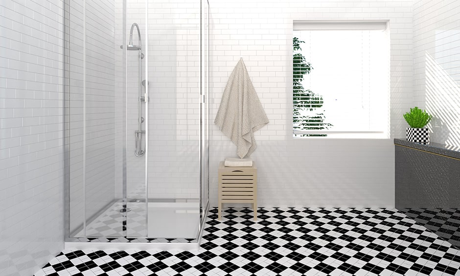 Black and white bathroom floor with a diamond pattern gives a beauty in your bathroom design
