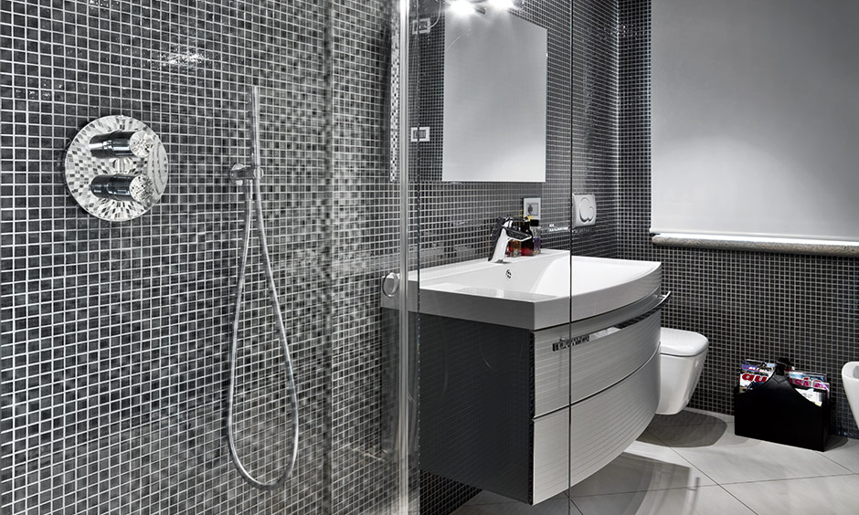 Black and white mosaic tile walls of bathroom design looks spacious