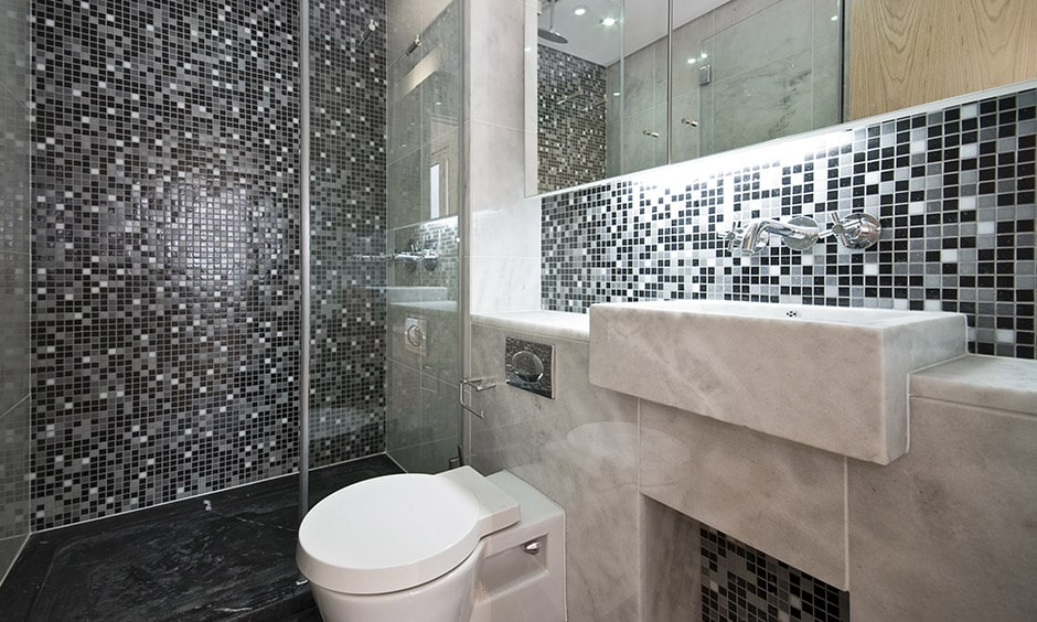 Mixing grey with black and white mosaic tile bathroom gives great look