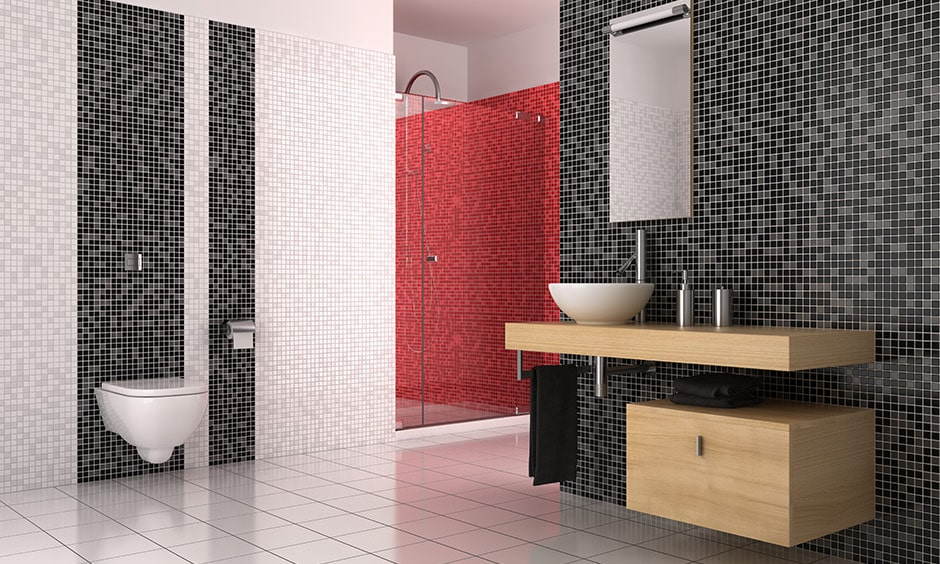 Black and white mosaic tile bathroom design with a pop of colour with red