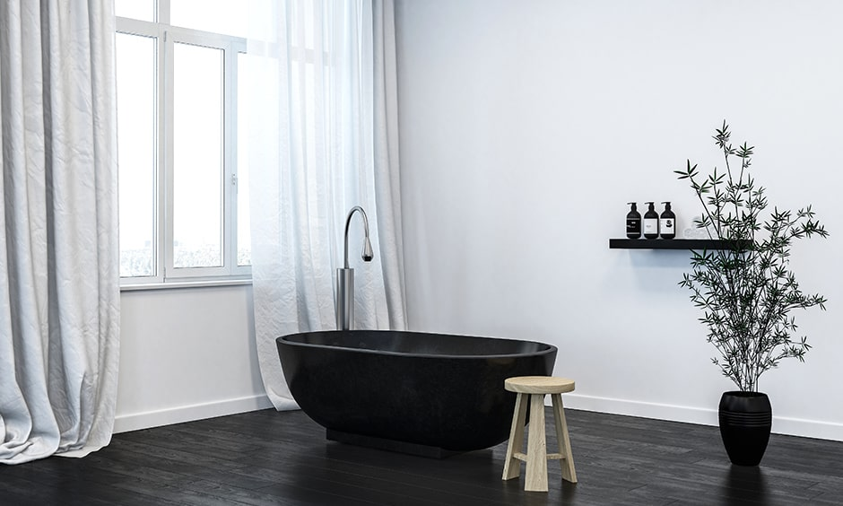 Modern black and white bathroom interior design with black vinyl flooring with white walls