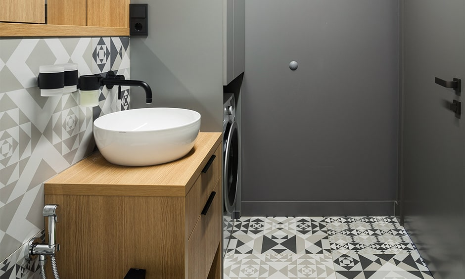 Use geometric patterned tiles for black and white bathroom design for a seamless look