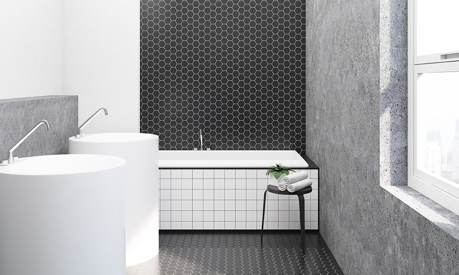 Latest trend in black and white bathroom design with small hexagon tiles