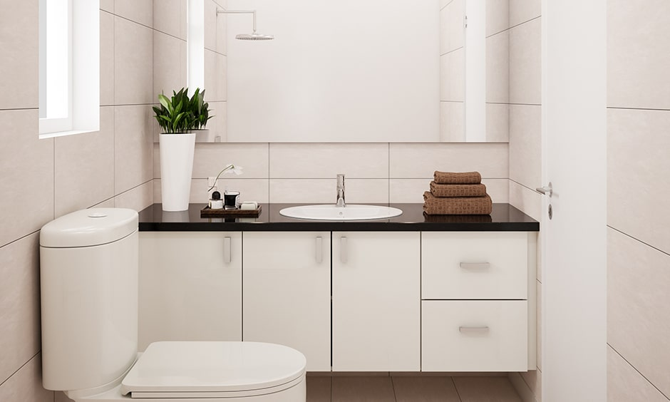 Black and white bathroom design with a black marble top gives your bathroom sleek look