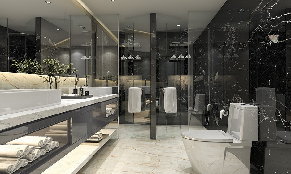 Modern black and white bathroom interior with a white marble floor paired with a black marble wall