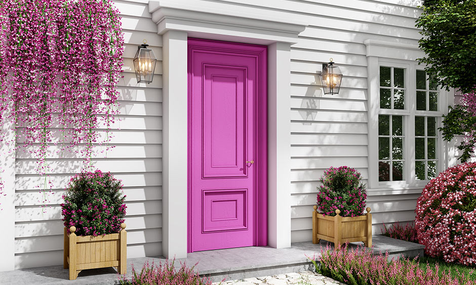 Front door paint color ideas with pink and gold or brass lighting on the side