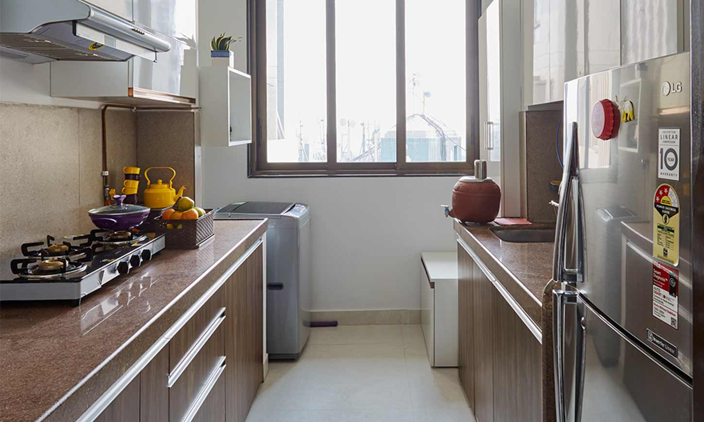 Modular kitchen designs mumbai with a parallel kitchen with brown countertops