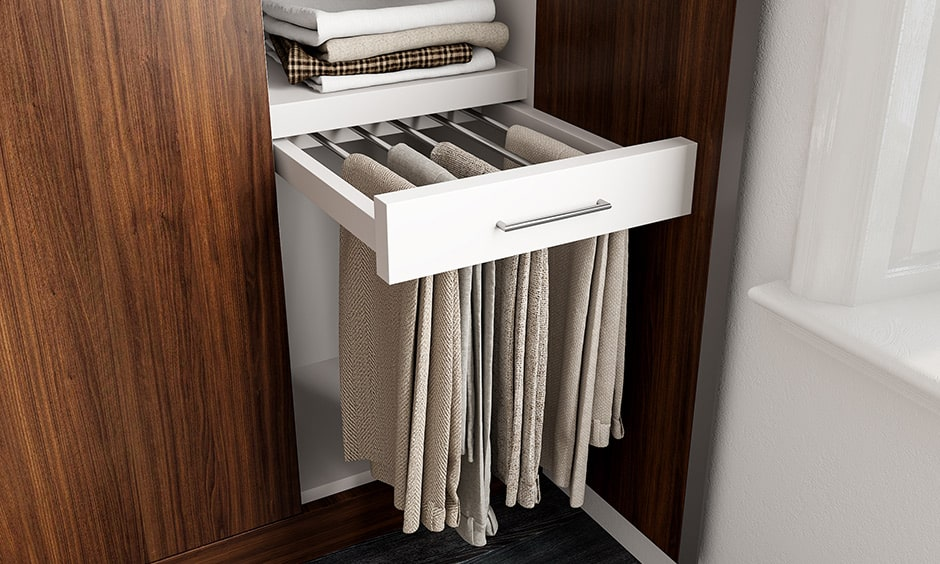 Trouser rack as a compartment for wardrobe to save space in the wardrobe and organise your clothes better.