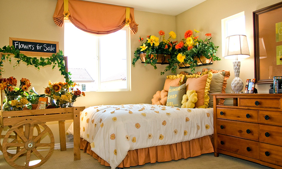 Decoration on mothers day this bedroom brings a summer's day feel with yellow and orange sunflowers.