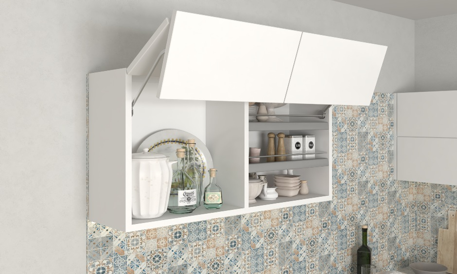 Bi fold lift up blue and white modular kitchen interior design for space saving in small kitchens in India