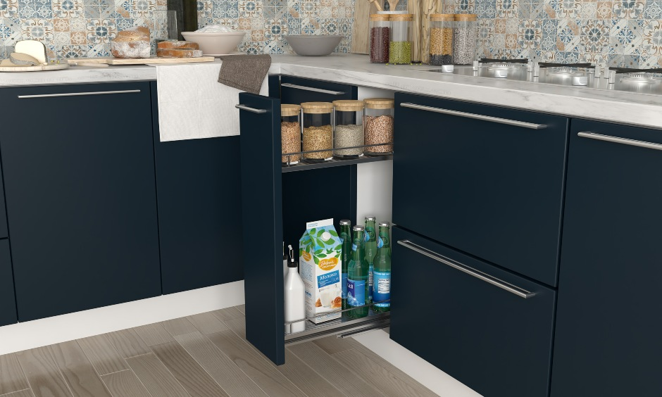 Navy blue and white kitchen design with a oil and spice pull out for storage in kitchen interiors hyderabad