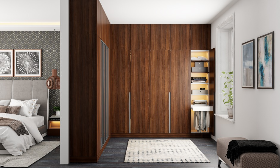 Wooden wardrobe design with space saving solution